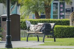 Old man sleeping with his back on a chair. Temple City, FEB 26: Old man sleeping with his back on a chair on FEB 26, 2019 at Temple City, California stock image