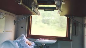 Old man is sleeping in the train. concept travel train wagon journey interior. economy wagon railway view from inside. Indoors. Railway interior passenger stock footage