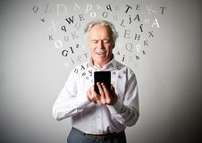Old man and smart phone. Royalty Free Stock Images