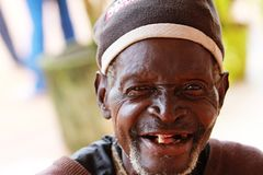 An old man smiling with no teeth. An old man, brother, father, grandfather, with a big grin showing his missing teeth royalty free stock photography