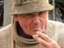 Old man smoking Royalty Free Stock Image