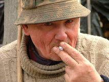 Old man smoking a cigarette Stock Photo