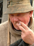 Old man smoking a cigarette Royalty Free Stock Photo