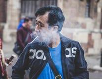 Old man smoking a cigarette