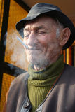 Old man smoking Stock Photos