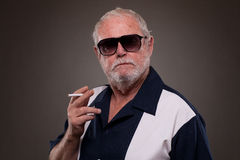 Old Man smoking cigarette Stock Image