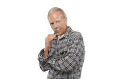 Old man smoking Electronic Vapor Cigarette Stock Image
