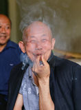 Old man smoking in gaomiao town,sichuan,china Stock Images