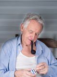 Old man smoking pipe Royalty Free Stock Photography