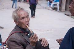Smoking old man Stock Photo
