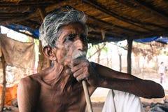 Old man smoking Stock Image
