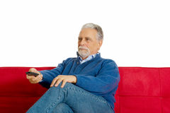 Old man on the sofa Royalty Free Stock Photo