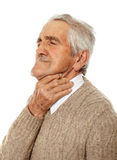 Old man with sore throat Stock Photography