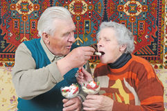 Old man spoon-feed old woman Stock Photo