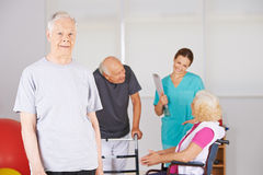 Old man standing in front of group of senior people Stock Photo