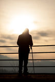 Old man standing in sunset with cane Stock Images