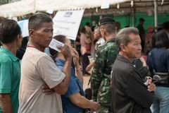 Old man stands in row for Pre-election at Khonkaen, Thailand stock photos