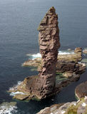 The 'Old Man of Stoer'. The Old Man of Stoer, a rocky outcrop (70m tall) in the north west Scottish Highlands with climbers acending stock photography