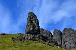 The Old Man of Storr. Gorgeous scenes of the Old Man of Storr in Scotland with blue skies and lush green landscape Stock Images