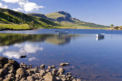 Old Man of Storr on the Isle of Skye in Scotland. Boats on Loch leathann with the old man of storr in the background stock images