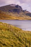 Old Man of Storr over Loch. The Old Man of Storr on the Isle of Skye taken over Loch Leathann. The Storr is reflected in the calm dawn waters of the loch royalty free stock photography
