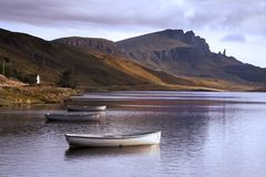 Old Man of Storr over Loch. The Old Man of Storr on the Isle of Skye taken over Loch Leathann. The Storr is reflected in the calm dawn waters of the loch royalty free stock image