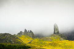 The old man of Storr rock and fog on Isle of Skye mountains. Scotland stock images
