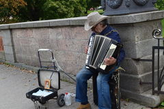 Old man. Street musician in the center of city royalty free stock image