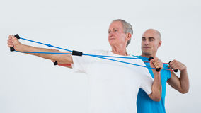Old man stretching elastic stock photography
