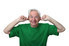 Old man stuffed his ears Stock Photo