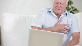 Old man with sudden pain in the heart Stock Photo