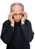 Old man suffering from a headache Royalty Free Stock Photos