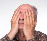 Old man suffering from a headache Stock Image
