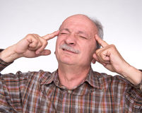 Old man suffering from a headache Stock Photography