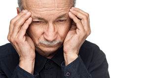 Old man suffering from a headache Stock Photo