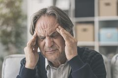 Old man suffering from headache. Old man suffering  from headache Royalty Free Stock Image