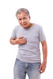 Old man suffering from heartburn, acid reflux Royalty Free Stock Photography