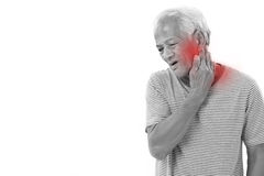Old man suffering from neck muscle inflammation or injury. With red alert accent Stock Photo