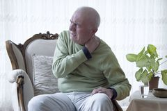 Old man suffering from pain stock photo