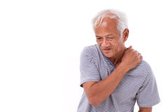 Old man suffering from shoulder muscle inflammation or injury. White isolated background Stock Photo