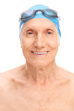 Old man with a swim cap and swimming goggles. Close-up on an old man with a blue swim cap and black swimming goggles isolated on white background stock images