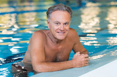 Old man swimming Stock Photography