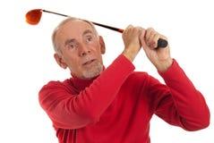 Old man swinging golf club Stock Image