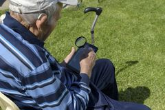 Old Man Tablet Magnifying glass Reading Royalty Free Stock Photo