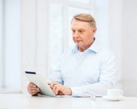 Old man with tablet pc computer at home Stock Photos