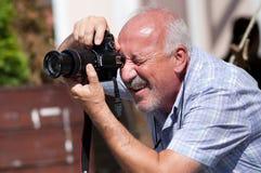 Old man taking photograph Royalty Free Stock Photo