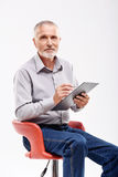 Old man taking a test Stock Image