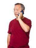 Old man talk to cellphone Royalty Free Stock Photography
