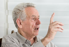Old man talking Royalty Free Stock Image