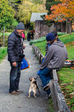 Old man talking with dog owners Royalty Free Stock Photography